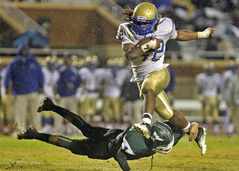 Phoebus' Marshawn Williams, right, hurdles Kecoughtan's Kashawn Lynch in the air during Friday's game at Darling Stadium.
