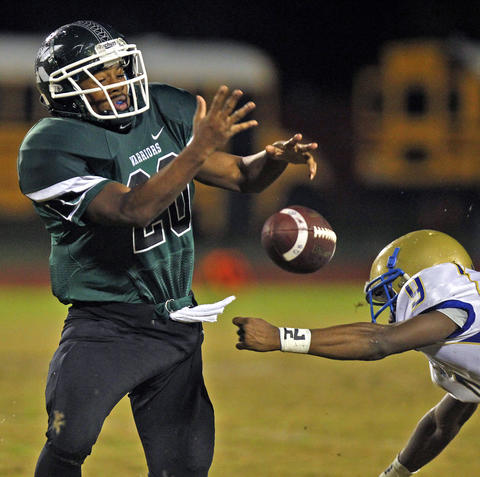 Kecoughtan's Victor Mitchell, left, drops the ball while being hit by Phoebus' Haasan Price for an incomplete pass during Friday's game at Darling Stadium.