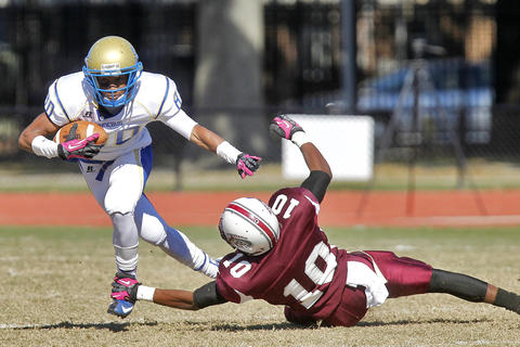 Phoebus' Darius Knight-Elliot, left, dodges the tackle of Heritage's Justice Faunlteroy during Saturday's game at Todd Stadium.