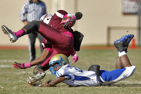 Phoebus' Khamal Linen, right, dives to tackle Heritage's ReSean Streater during Saturday's game at Todd Stadium.