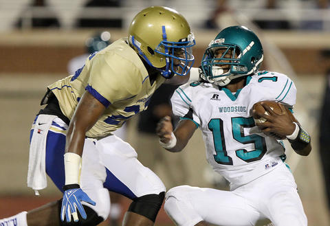 Michael Hunt of Phoebus gets to Woodside quarterback L.J. Taylor during the second quarter Friday at Darling.