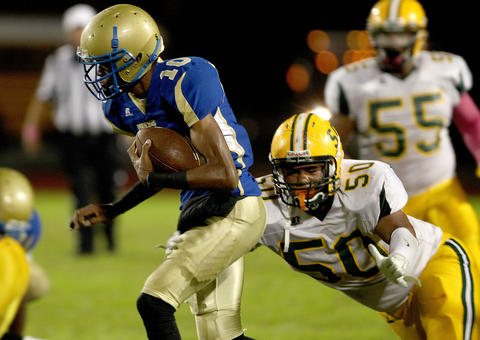 Phoebus quarterback Terrell Toliver is tracked down by Ricky Walker of Bethel as he scrambles during the first quarter Friday.