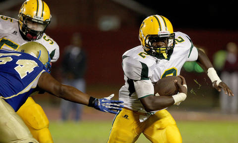 Kerron Jones of Bethel tires to get away from Kevin Lyles of Phoebus during the third quarter Friday at Darling Stadium.