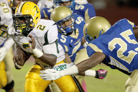 Kerron Jones of Bethel looks for running room against Michael Hunt of Phoebus during the third quarter Friday at Darling.