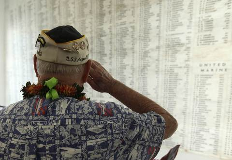 "USS Arizona survivor Louis Conter salutes after placing a wreath at the ""Remembrance Wall"" on board the USS Arizona Memorial during the 72nd anniversary of the attack on Pearl Harbor at the WW II Valor in the Pacific National Monument in Honolulu, Hawaii on December 7, 2013."