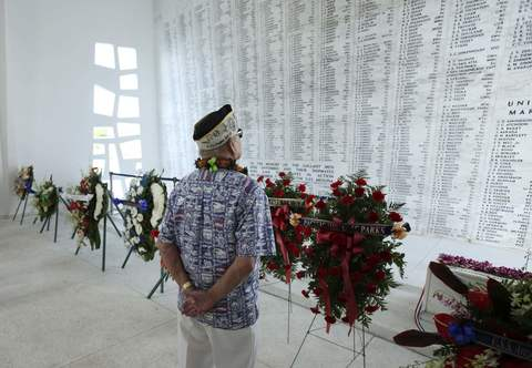 "USS Arizona survivor Louis Conter looks at names of sailors that died on the ""Remembrance Wall"" during a wreath presentation ceremony on board the USS Arizona Memorial during the 72nd anniversary of the attack on Pearl Harbor at the WW II Valor in the Pacific National Monument in Honolulu, Hawaii on December 7, 2013."