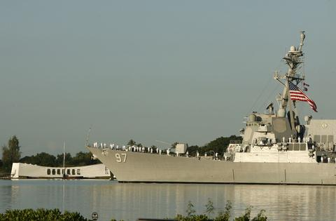 The USS Halsey passes the Arizona Memorial during the 72nd anniversary of the attack on Pearl Harbor at the WW II Valor in the Pacific National Monument in Honolulu, Hawaii on December 7, 2013.