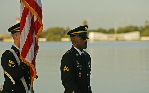 The US Army Color Guard stands at attention at the Arizona Memorial during the 72nd anniversary of the attack on Pearl Harbor at the  WW II Valor in the Pacific National Monument in Honolulu, Hawaii on December 7, 2013.