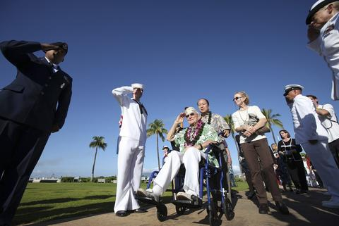"Pearl Harbor survivor Everett Highland salutes during the ""Walk of Honor"" at the 72nd anniversary of the attack on Pearl Harbor at the WW II Valor in the Pacific National Monument in Honolulu, Hawaii on December 7, 2013."
