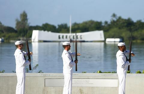 The U.S. Navy Ceremonial Guard performs a rifle salute at the Arizona Memorial during the 72nd anniversary of the attack on Pearl Harbor at the WW II Valor in the Pacific National Monument in Honolulu, Hawaii on December 7,2013.