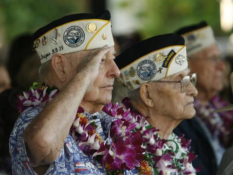 "USS Arizona survivor Louis Conter salutes during the ""Moment of Silence"" during the 72nd anniversary of the attack on Pearl Harbor at the WW II Valor in the Pacific National Monument in Honolulu, Hawaii on December 7, 2013."