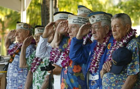 Pearl Harbor survivors salute as the USS Halsey passes the Arizona Memorial during the 72nd anniversary of the attack on Pearl Harbor at the WW II Valor in the Pacific National Monument in Honolulu, Hawaii on December 7, 2013.