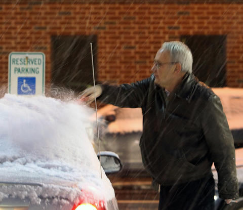 Dan Rambo, scrapes the snow off of his car in Allentown Sunday December 8, 2013.