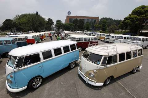 Various models of Volkswagen's Kombi minibus are displayed during a Kombi fan club meeting in Sao Bernardo do Campo December 8, 2013. Volkswagen Brazil, the last plant to produce the Kombi, will cease production of the iconic vehicle on December 20 after 56 years of production. Higher manufacturing costs and increase in production time due to new auto regulations, which will require anti-lock brake systems and air bags in all cars produced in Brazil from 2014, contributed to its decision to stop the production of the Kombi, according to the company.