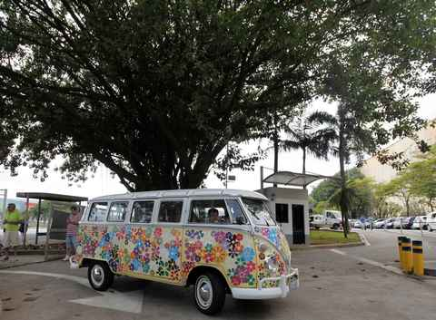 A customized Volkswagen Kombi minibus arrives to a Kombi fan club meeting in Sao Bernardo do Campo December 8, 2013. Volkswagen Brazil, the last plant to produce the Kombi, will cease production of the iconic vehicle on December 20 after 56 years of production. Higher manufacturing costs and increase in production time due to new auto regulations, which will require anti-lock brake systems and air bags in all cars produced in Brazil from 2014, contributed to its decision to stop the production of the Kombi, according to the company.
