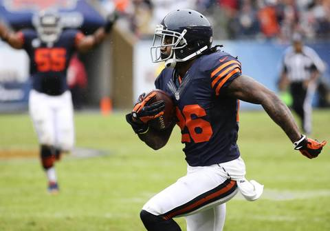 Week 2: Tim Jennings of the Bears returns an interception for a touchdown in the second quarter against the Vikings.