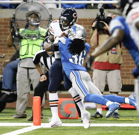 Earl Bennett scored on a 10-yard pass from Jay Cutler in the fourth quarter of a 40-32 loss to the Lions.