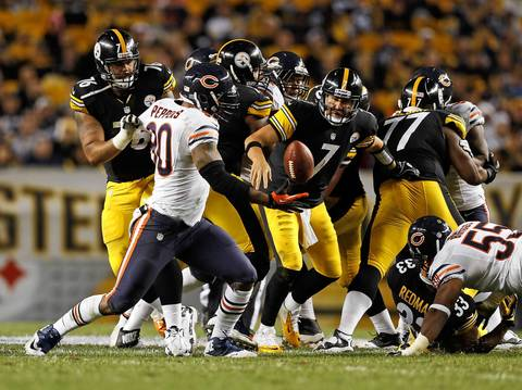 Julius Peppers returned a Ben Roethlisberger's fumble 42 yards for a touchdown late in the fourth quarter.