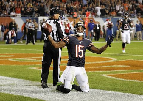 Brandon Marshall celebrates his first touchdown of the game against the Giants, a 10-yard pass in the 2nd quarter.