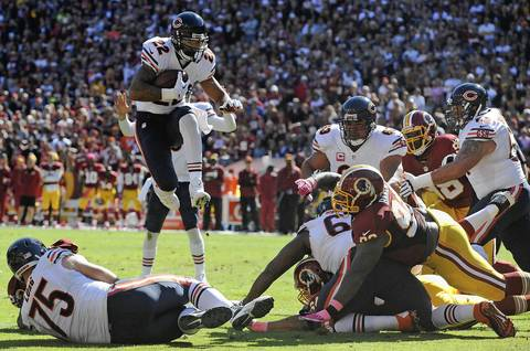 Matt Forte hurdled over a defender for a two-yard touchdown scamper in the first quarter against the Redskins.