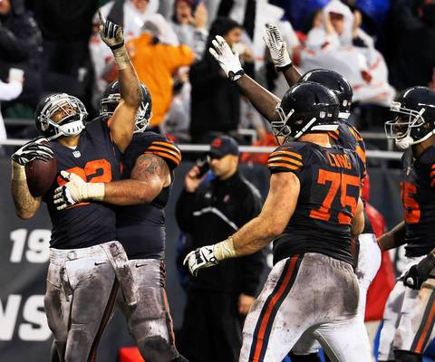 Matt Forte celebrates after his 14-yard touchdown catch in the fourth quarter that tied the game against the Ravens.
