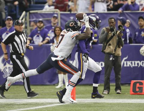 Alshon Jeffery catches a 46-yard touchdown pass in front of Vikings cornerback Chris Cook during the third quarter.