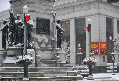 Monuments at Allentown Center Square are covered in snow Tuesday morning.