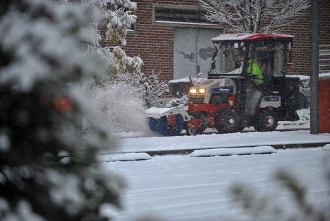 A worker plows the sidewalks on 6th Street in Allentown as snow accumulates in the Lehigh Valley Tuesday morning.