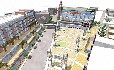 This rendering looks north on Clark from the intersection with Addison. On the left is the proposed hotel, health club, dining and retail development. On the right is the plaza planned by the Cubs along with an office building for the team. An elevated walkway over Clark Street would connect the two spaces. The obelisks on the plaza would feature static advertisements.