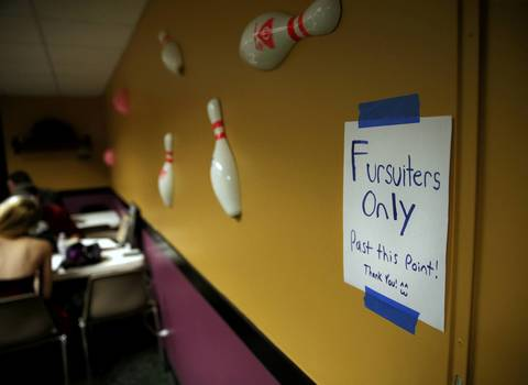 A sign on the wall informs people of a fursuiter only area at Tivoli Bowl in Downers Grove.
