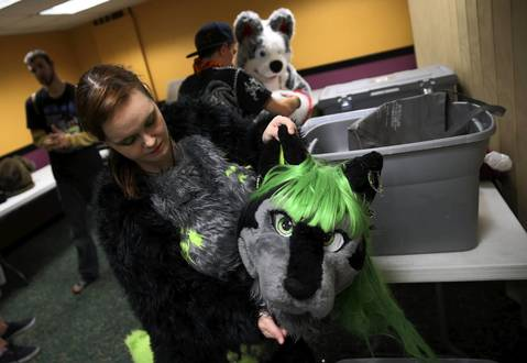 Gina Marcucci gets dressed in her wolf suit.