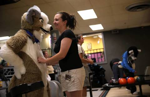 Mike Nicely, 24, of Lake Bluff, dressed as Woofie McBarkums, shares a moment with his girlfriend, Maggie Solum, 22, of Gurnee.