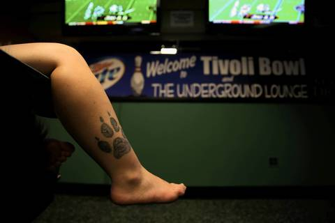 Andrea Hyde, 17, of Kenosha, Wis., sports a wolf face in a paw print tattoo.