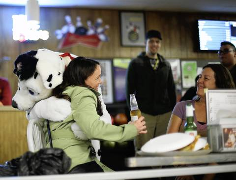 Edee Hart, 45, of Westmont, receives a hug from Jamie Joyce, 40, of South Bend, Ind., dressed as a Dalmatian named Spark.
