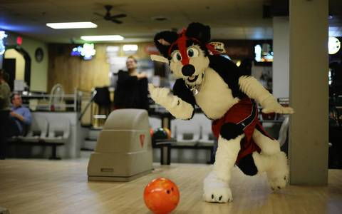 Vincent Prusak is dressed as a Husky named Razz Husky on bowling night.