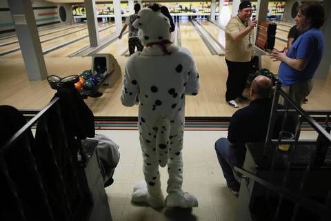 Jamie Joyce, dressed as a Dalmatian named Spark, walks to his lane.