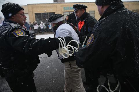 A protester is arrested by police after blocking the entrance of an immigrant detention center on December 10, 2013 in Elizabeth, New Jersey. A coalition of immigrant advocacy groups called 'Not One More Deportation' marked international Human Rights Day, staging the civil disobedience action at the Elizabeth Detention Center, and eight protesters were arrested by police. Organizers said the event was designed to draw attention to the continued mass deportations of undocumented immigrants by U.S. Immigration and Customs Enforcement (ICE), as well as Congress' inability to pass immigration reform. The Obama administration is on track to have removed 2 million immigrants from the United States, the most of any presidential administration.
