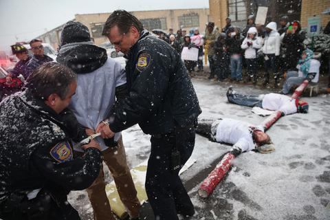Police arrest protesters blocking the entrance of an immigrant detention center on December 10, 2013 in Elizabeth, New Jersey. A coalition of immigrant advocacy groups marked international Human Rights Day, staging the civil disobedience action at the Elizabeth Detention Center, and eight protesters were arrested. The event was designed to draw attention to the continued mass deportations of undocumented immigrants by the U.S. Immigration and Customs Enforcement (ICE), as well as Congress' inability to pass immigration reform. The Obama administration is on track to have removed 2 million immigrants from the United States, the most of any presidential administration.