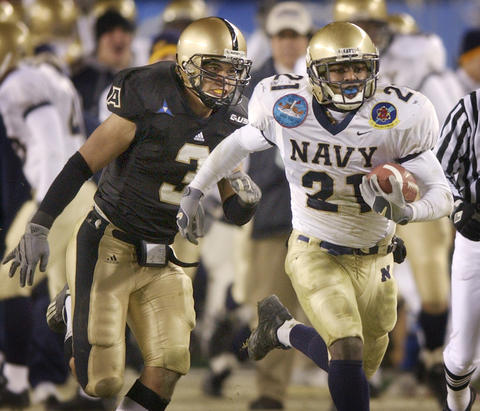 Navy's Tony Lane, is pursued by Army's Mikel Resnick as he breaks a 54-yard run in the fourth quarter in 2003.