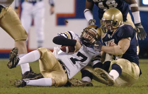 Navy's Josh Smith sacks Army's Zac Dahman in the third quarter in 2004.