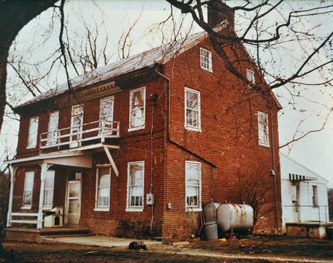 A photo of house before the Krohs' restoration. The house had been condemned. Appler-Englar Farm, a Federal-style home built in 1790, has been the home of John and Sandi Kroh since 1972.