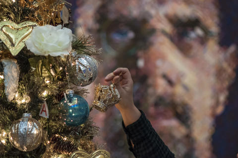 "2013.12.01 - Hartford, CT - Artist Angham Zakko set up a tree named ""My Sunshine Forever,"" in front of a Chuck Close photograph in the Morgan Great Hall. The Wadsworth Festival of Trees and Traditions runs through December 14."