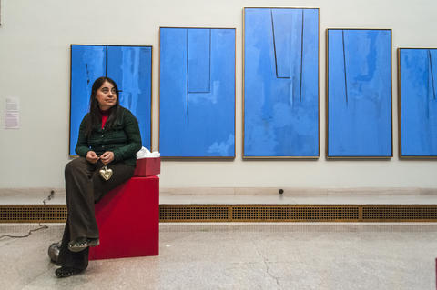"2013.12.01 - Hartford, CT - In front of a Robert Motherwell painting named ""The Blue Painting Lesson: A Study in Painterly Logic, Artist Angham Zakko gazes around the Great Morgan Hall while taking a break from decorating her tree named ""My Sunshine Forever."""