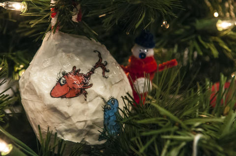 "2013.12.01 - Hartford, CT - A red fish and a blue fist on a bulb adorn a tree decorated by ""Bright Horizons at Village Place,"" and named ""Wonderful World of Dr. Seuss."""