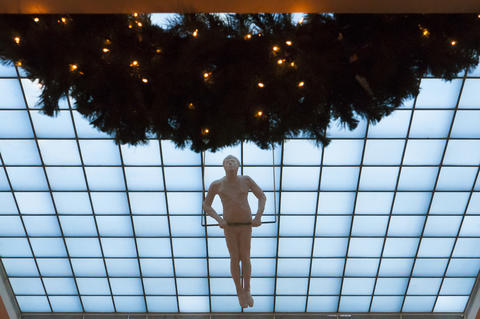 "2013.12.01 - Hartford, CT - ""Trapeze"" by George Segal hangs over a wreath and under a grid of skylights for the Wadsworth Museum's 40th Annual Festival of Trees & Traditions. Running through December 14, the nine-day event showcases holiday trees and wreaths decorated by Hartford area artists and organizations."