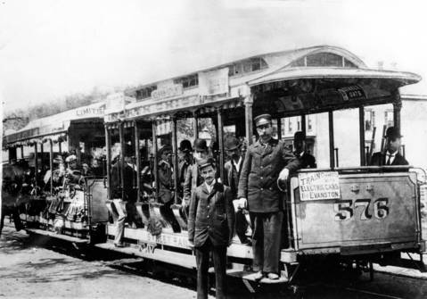 An 1892 Chicago cable streetcar, which replaced horse-drawn cars, was powered by a cable running underground between the tracks. The car and its conductors are at Wells and Clark Streets.
