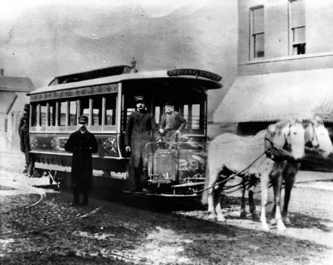 A horse-drawn streetcar at Grand Avenue and Leavitt Street, ca. 1886.