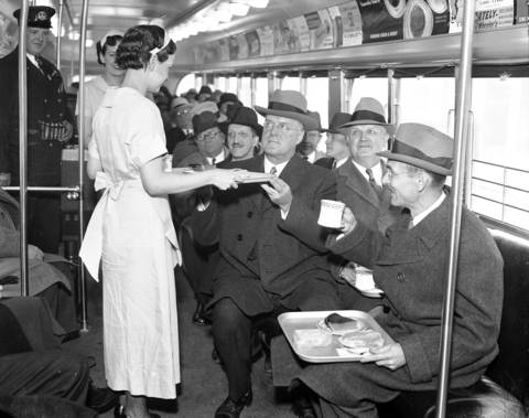 Waitress Elizabeth Riley serves the Chicago Surface Lines President, Guy A. Richardson, the Chicago City Railway Receiver, Harvey B. Fleming, and the Managing Director of the American Transit Association, Charles Gordon, on the new streamlined streetcars on Nov. 12, 1936.