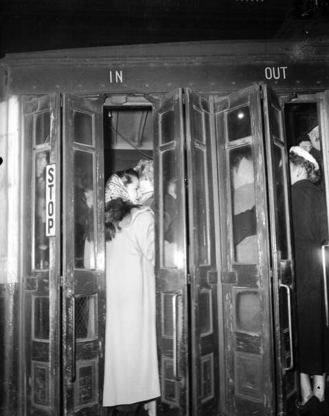 The rear platform of the Milwaukee Avenue streetcar is so crowded at North Avenue that women are stuck in the door as the conductor tries to close it on Jan. 20, 1950.