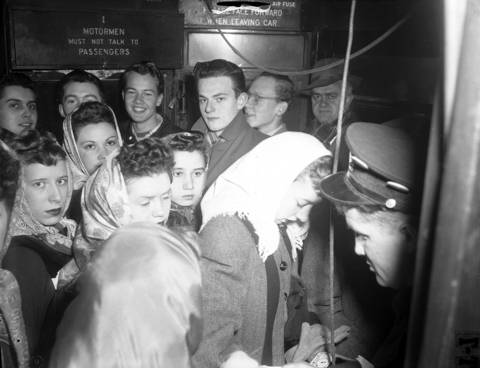 A crowd is jammed onto the rear platform of the Milwaukee Avenue streetcar heading for the Loop during rush hour on Jan. 20, 1950.
